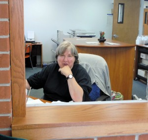 Renee greets in office